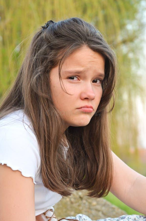 Ledsen flicka arkivbild