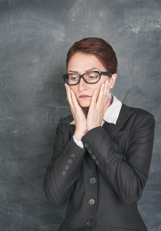 Ledsen lärare royaltyfria bilder