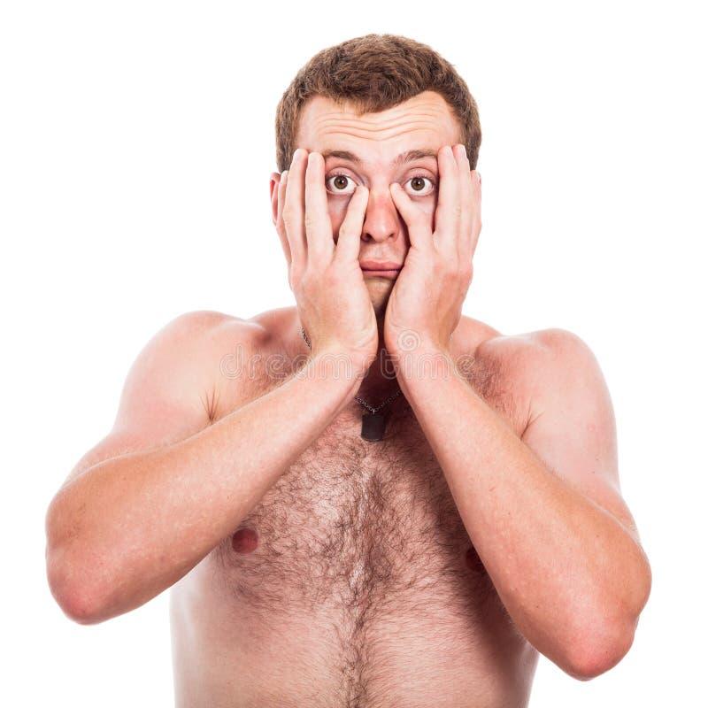 Ledsen shirtless man fotografering för bildbyråer