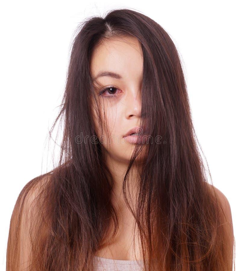 Ledsen ung asiatisk kvinna arkivfoton