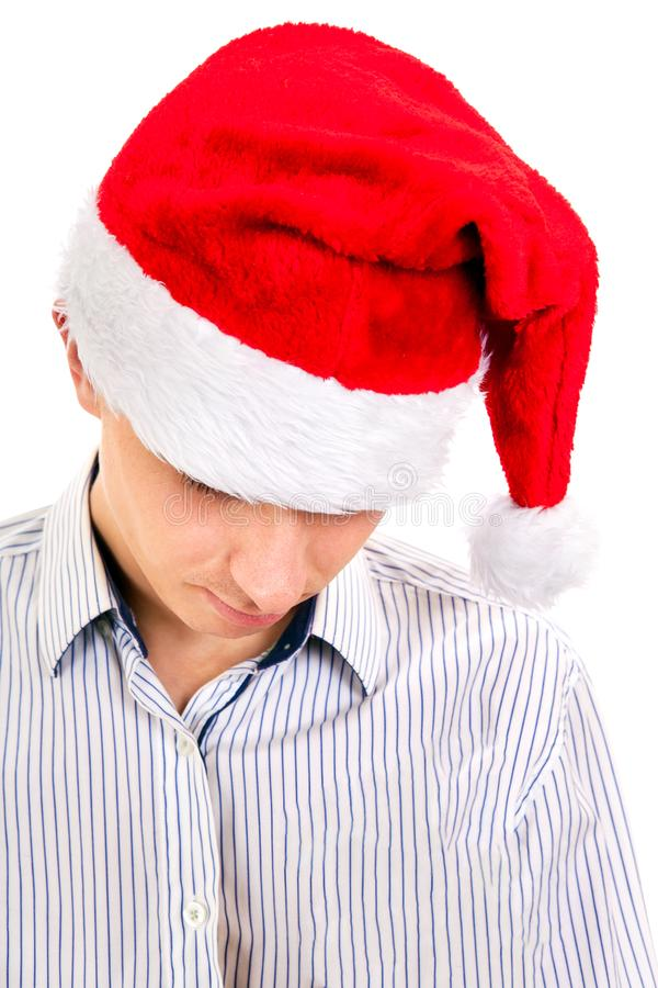 Ledsen ung man i Santa Hat royaltyfri bild