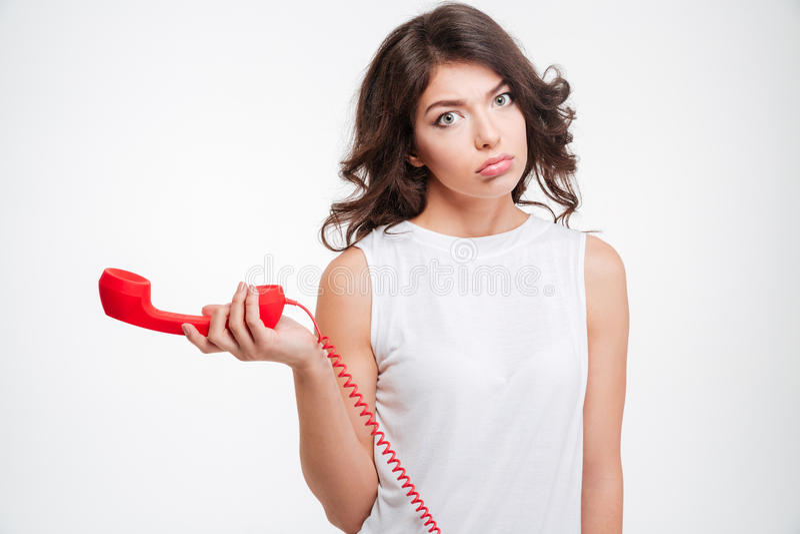 Ledset rör för kvinnainnehavtelefon royaltyfri bild