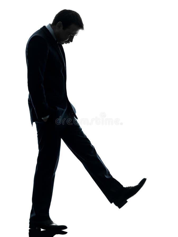 Ledset se för affärsman besegrar silhouetten royaltyfri foto