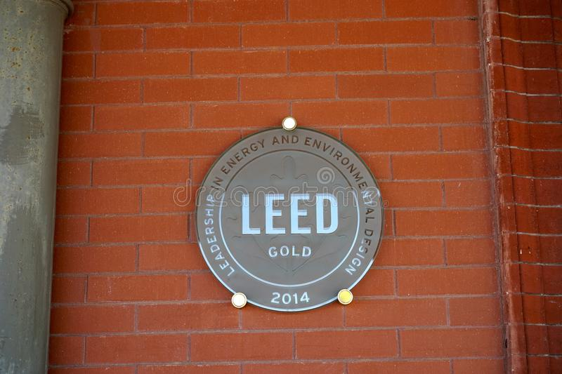 LEED gold certified building and seal. LEED stand for leadership in energy and environmental design. It is a prestigious much sought after award and designation royalty free stock photography