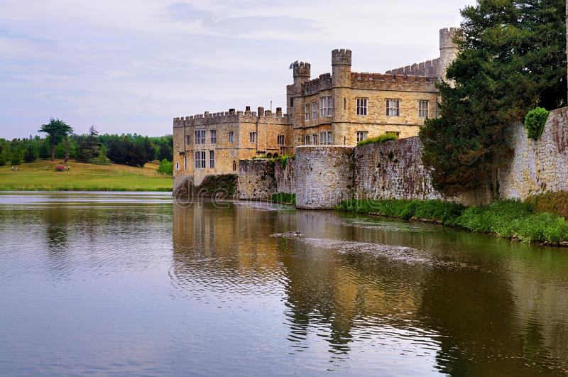 Leeds Castle, UK. Leeds Castle in England reflected in the water of the pond surrounding the castle stock photography