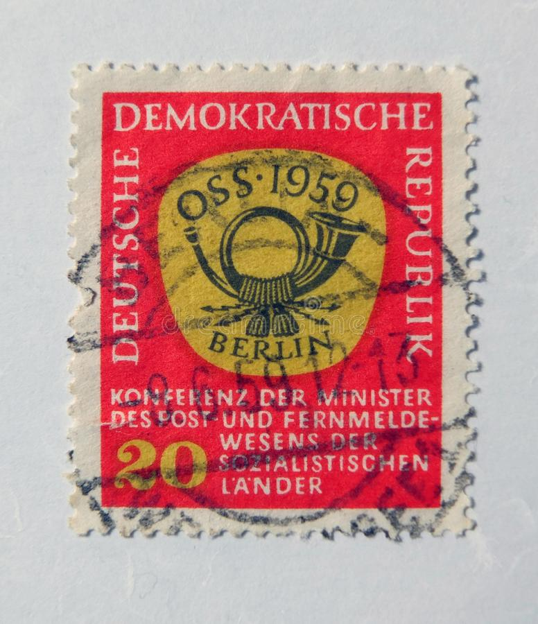 An old red east german postage stamp with postal horn design royalty free stock image