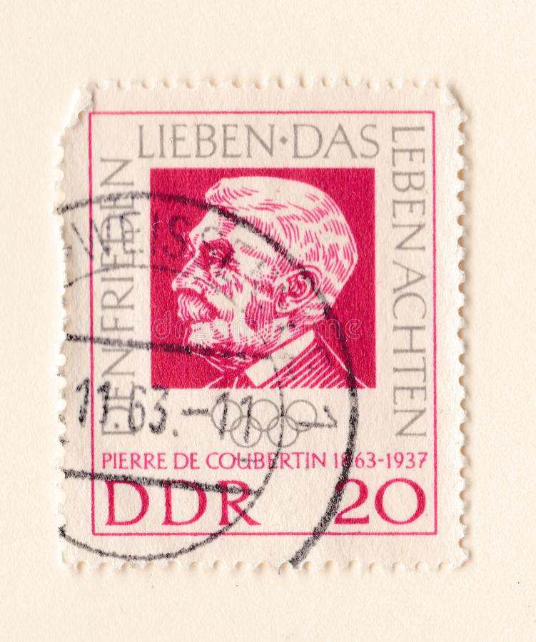 An old red east german stamp with an image of Baron Pierre de Coubertin founder of the International Olympic Committee stock images