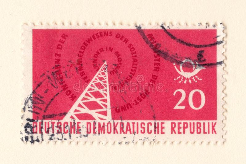 An old red east german stamp with an image of a radio transmitter royalty free stock photos