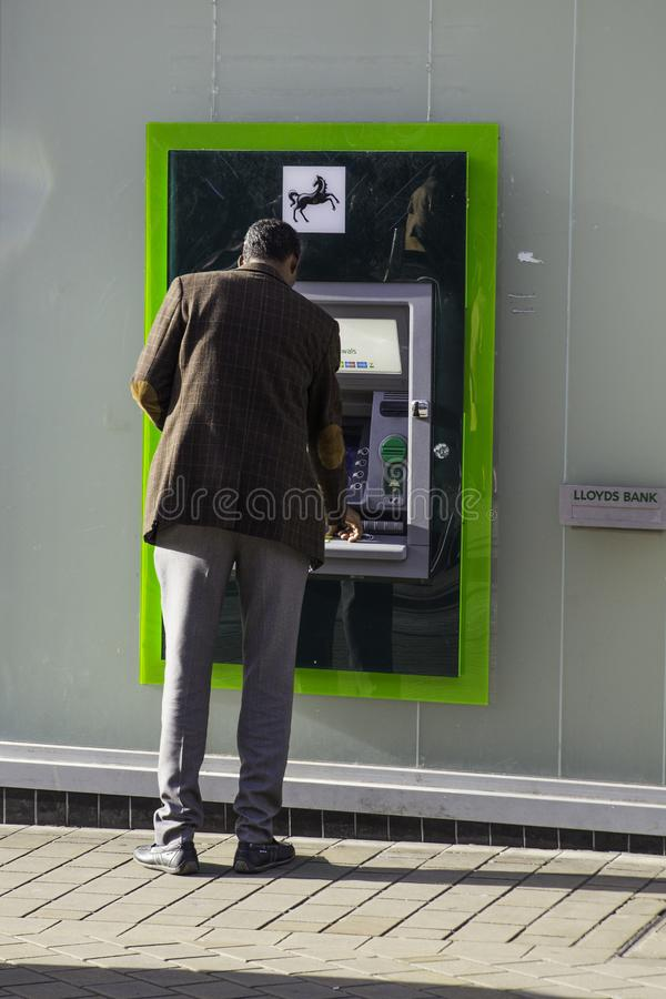 Lloyds Bank Cash Machine being use stock images