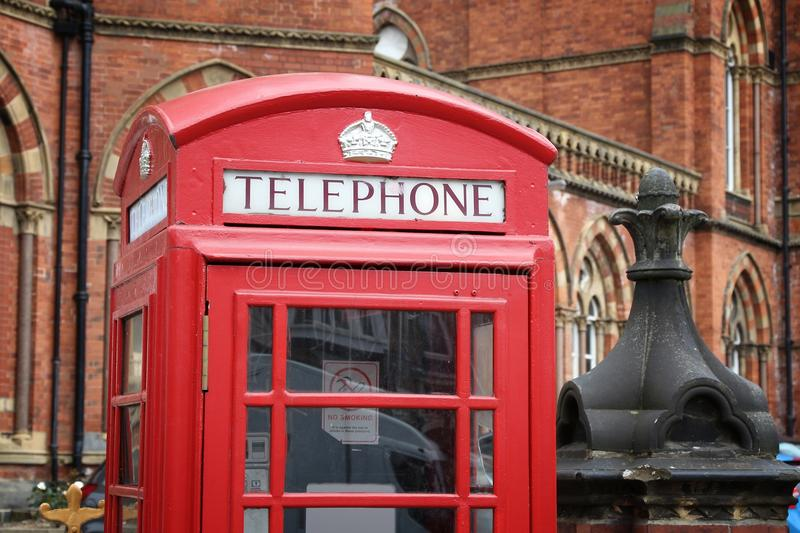 Leeds UK. Leeds, UK. Red telephone and Leeds General Infirmary in background royalty free stock photography