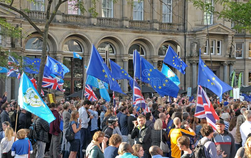 A crowd with flags and banners at the leeds for europe anti brexit demonstration. Leeds, west yorkshire, united kingdom - 29 august 2019: a crowd with flags and royalty free stock images