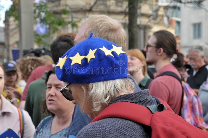 A woman wearing a european flag beret at the leeds for europe anti brexit demonstration. Leeds, west yorkshire, united kingdom - 29 august 2019: a woman wearing stock images