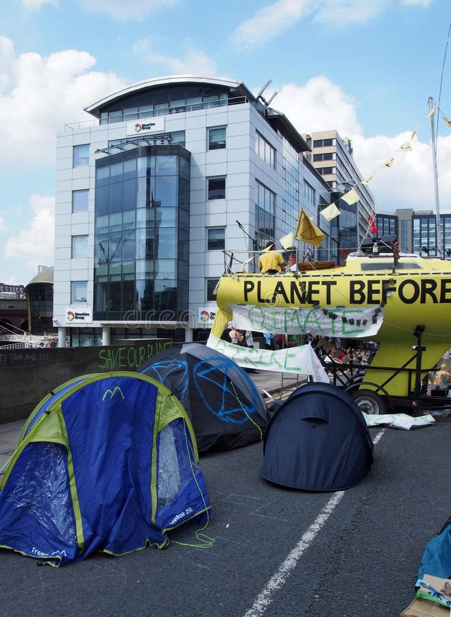 The large yellow boat tents and people in the road at the extinction rebellion protest blocking victoria bridge in leeds royalty free stock photography