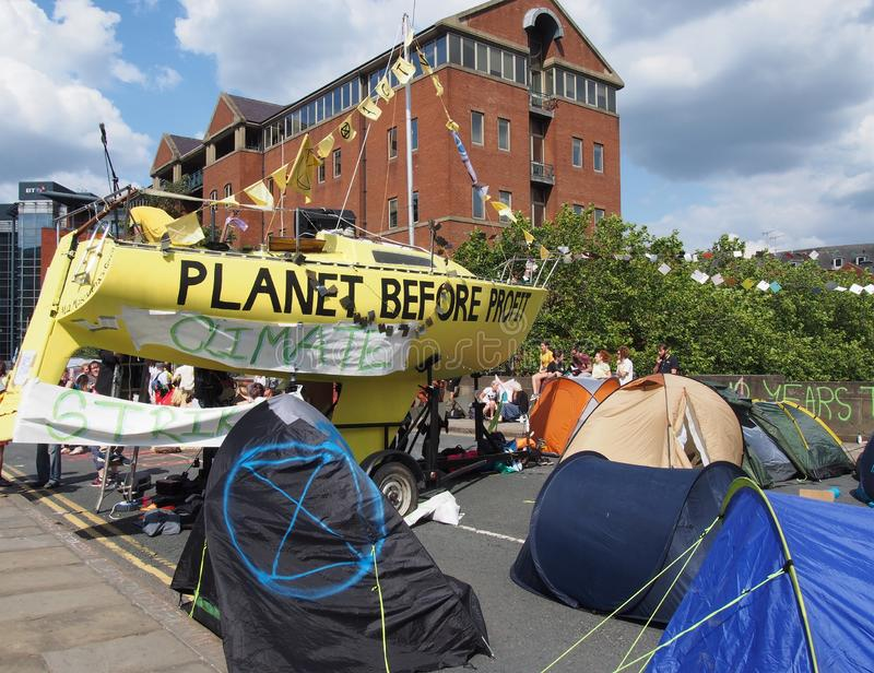 The large yellow boat tents and people in the road at the extinction rebellion protest blocking victoria bridge in leeds royalty free stock photos