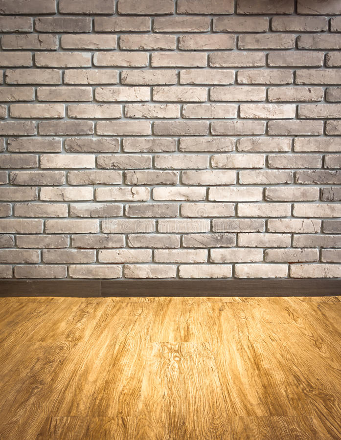 Leeg binnenlands perspectief met grungebakstenen muur en houten parqu royalty-vrije stock foto