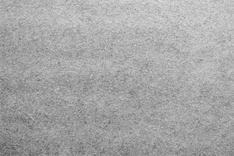 Leeg blad van document of triplex in grijze kleuren stock foto