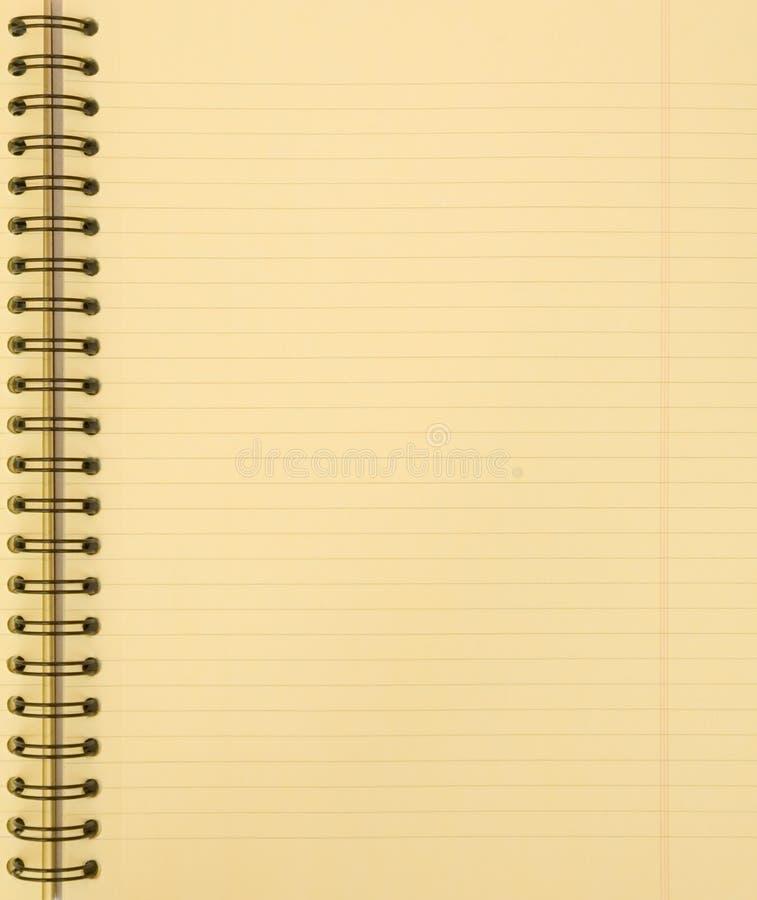 Leeg geel notitieboekje stock afbeeldingen