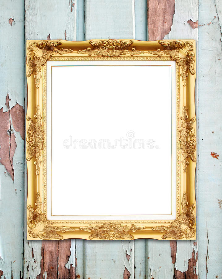Leeg gouden kader op houten muur stock foto