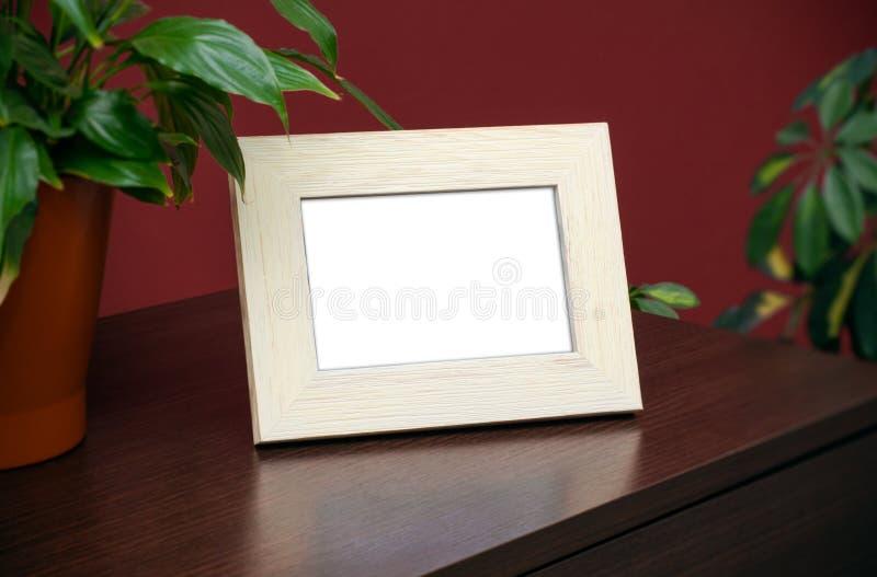 Leeg houten fotokader stock foto