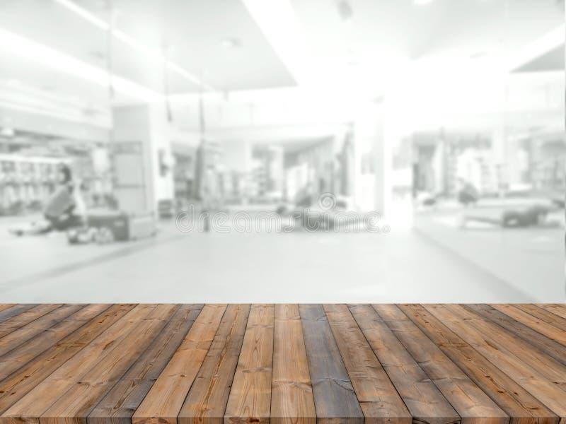 Leeg houten raads ruimteplatform met de gymnastiek van de onduidelijk beeldgeschiktheid stock afbeelding