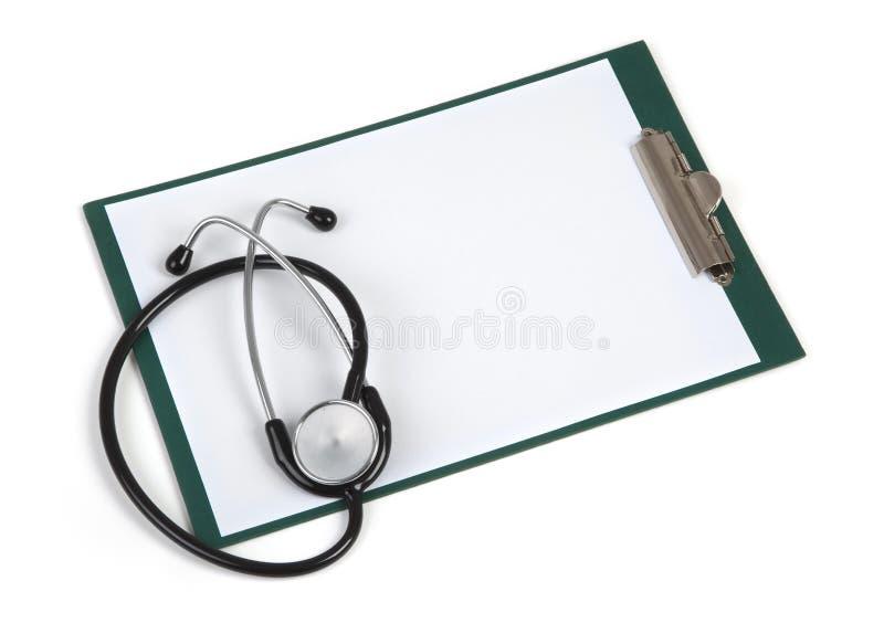Leeg klembord met stethoscoop stock afbeelding
