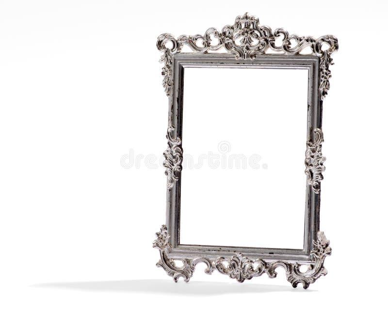Leeg uitstekend decoratief zilveren kader, op wit stock afbeelding