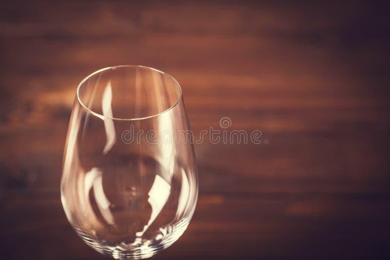 Leeg Wijnglas tegen stock foto