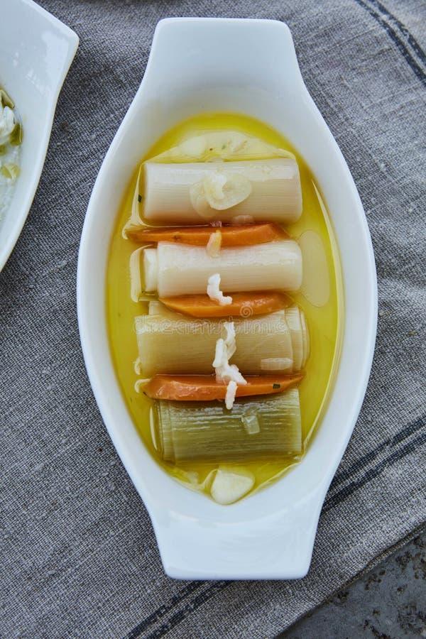 Cooked leek and carrot. Leek and carrot cooked in olive oil stock image