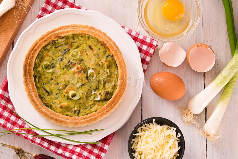 Leek quiche. Leek quiche with hot chilli pepper on white dish royalty free stock photo