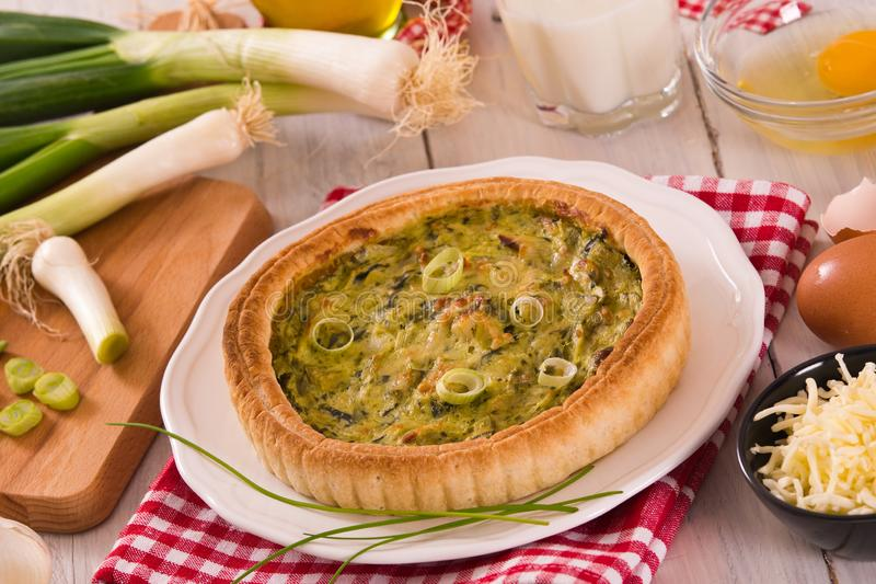 Leek quiche. Leek quiche with cheese on white dish stock photos