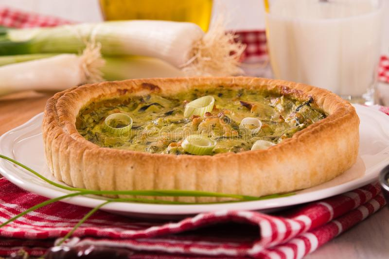 Leek quiche. Leek quiche with cheese on white dish royalty free stock photography