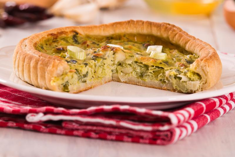 Leek quiche. Leek quiche with cheese on white dish stock photography
