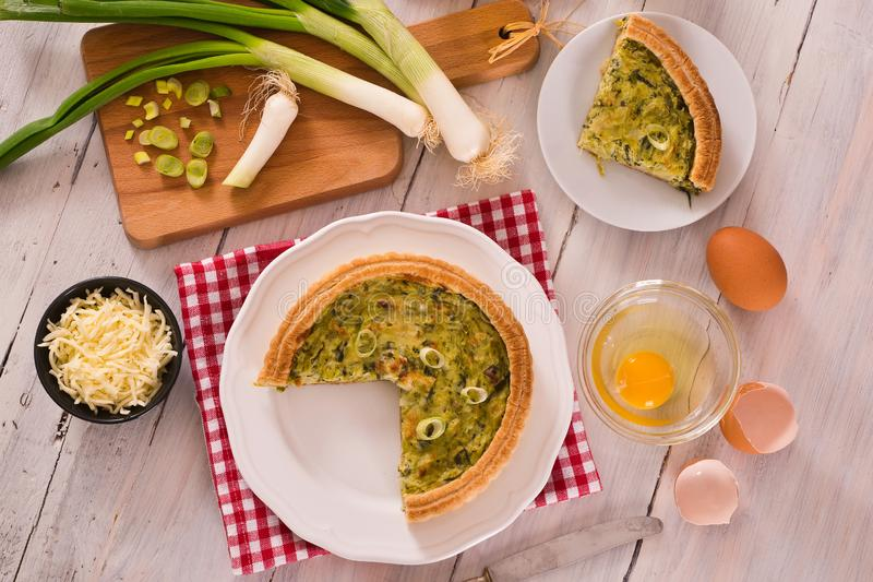 Leek quiche. Leek quiche with cheese on white dish stock photo