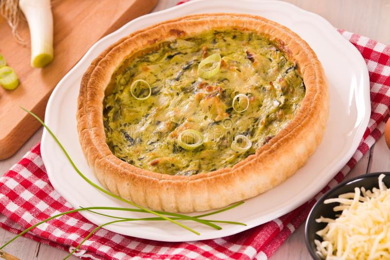 Leek quiche. Leek quiche with hot chilli pepper on white dish stock photo