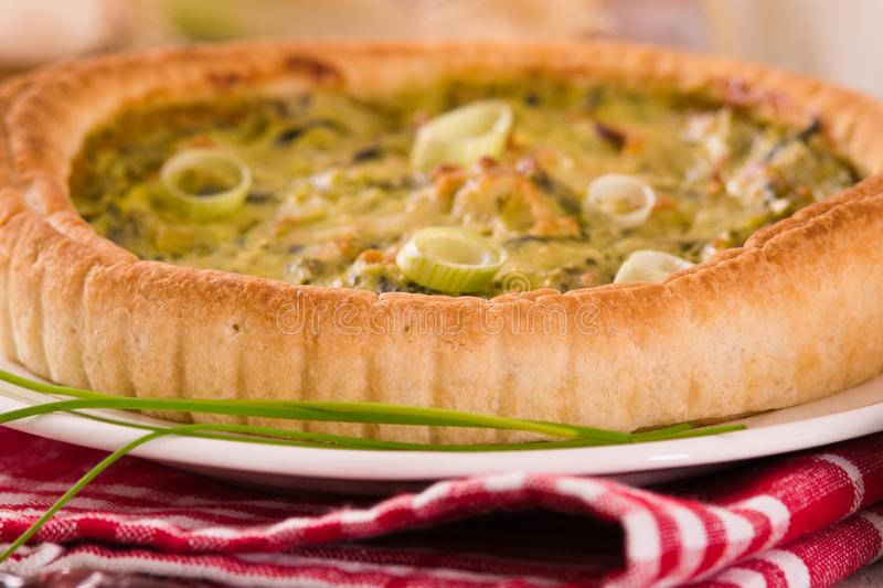 Leek quiche. Leek quiche with hot chilli pepper on white dish royalty free stock photos