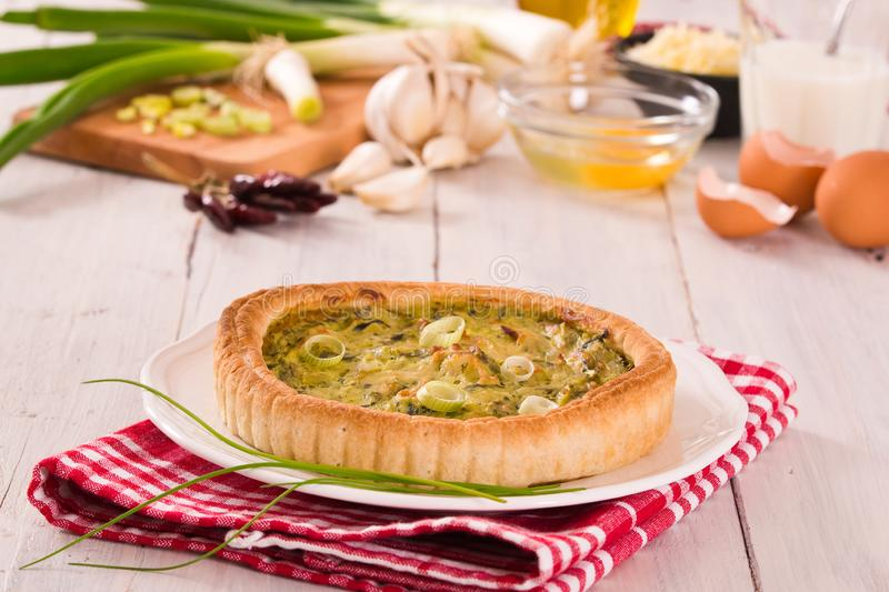 Leek quiche. Leek quiche with hot chilli pepper on white dish stock images