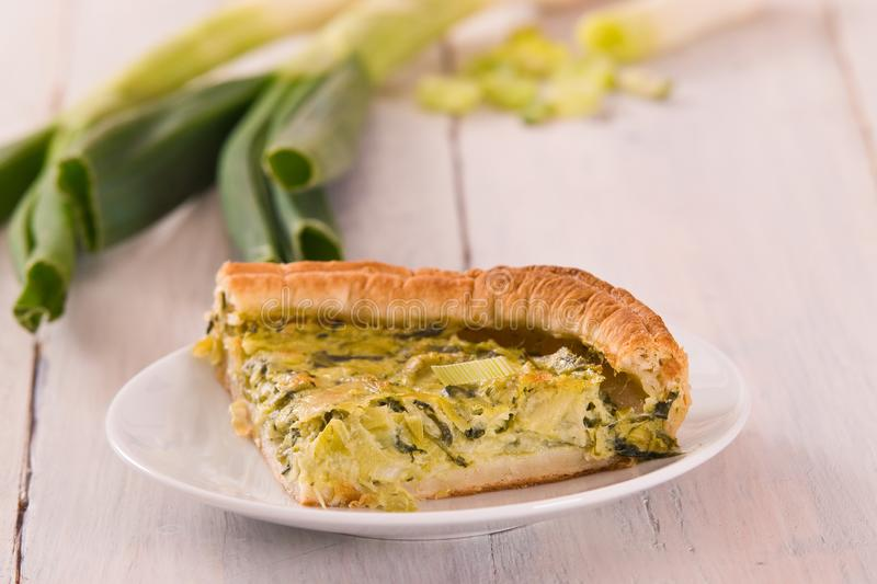 Leek quiche. Leek quiche with hot chilli pepper on white dish royalty free stock photography