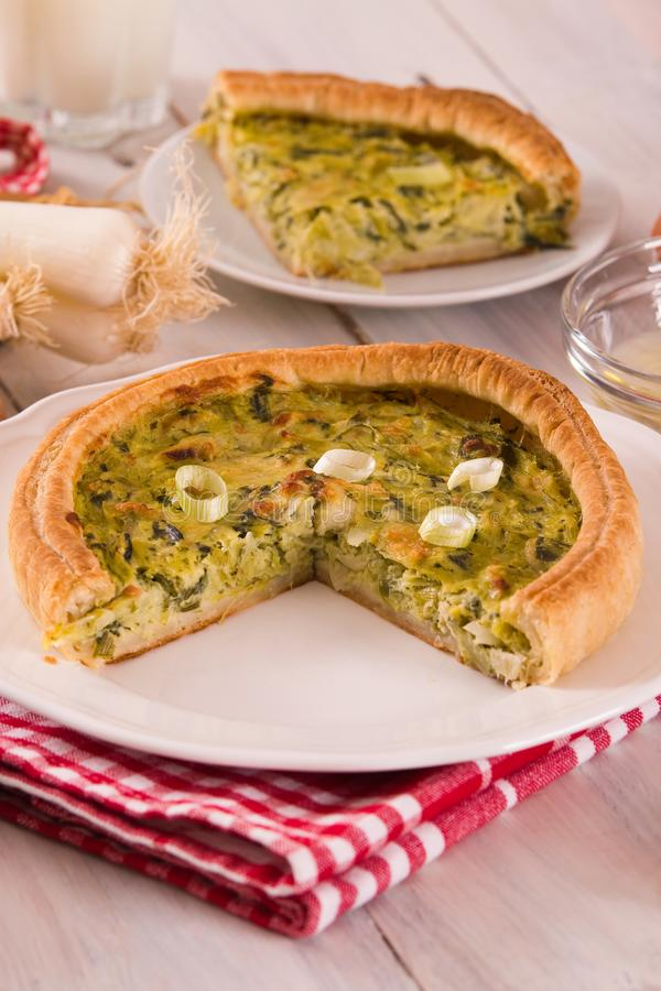 Leek quiche. Leek quiche on wooden table royalty free stock images