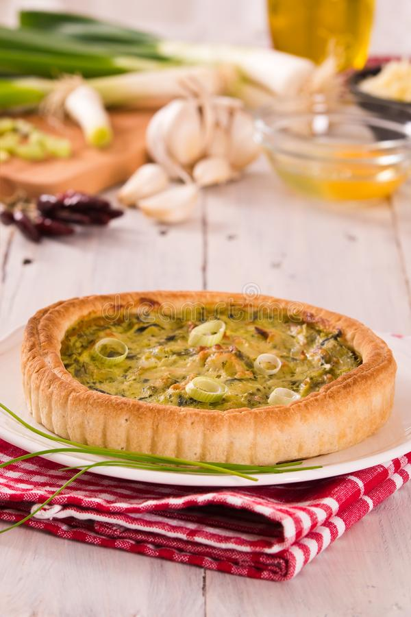Leek quiche. Leek quiche on wooden table stock photography