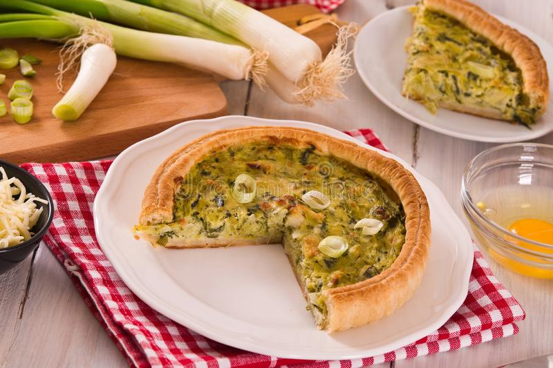 Leek quiche. Leek quiche on wooden table royalty free stock photography