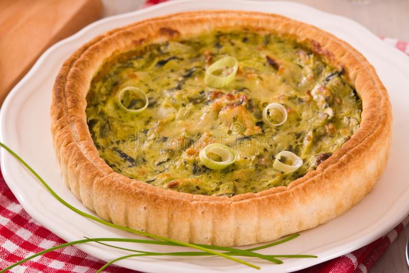 Leek quiche. Leek quiche on wooden table royalty free stock photos