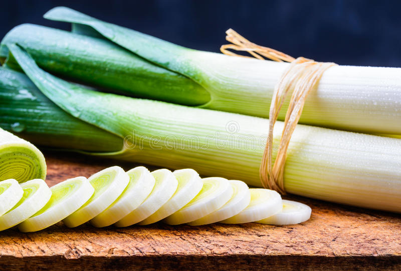 Leek on rustic wood background. stock photography