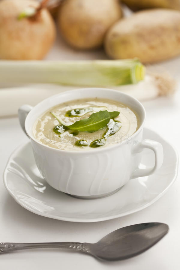 Leek soup. Tasty home made leek soup on white cup stock image