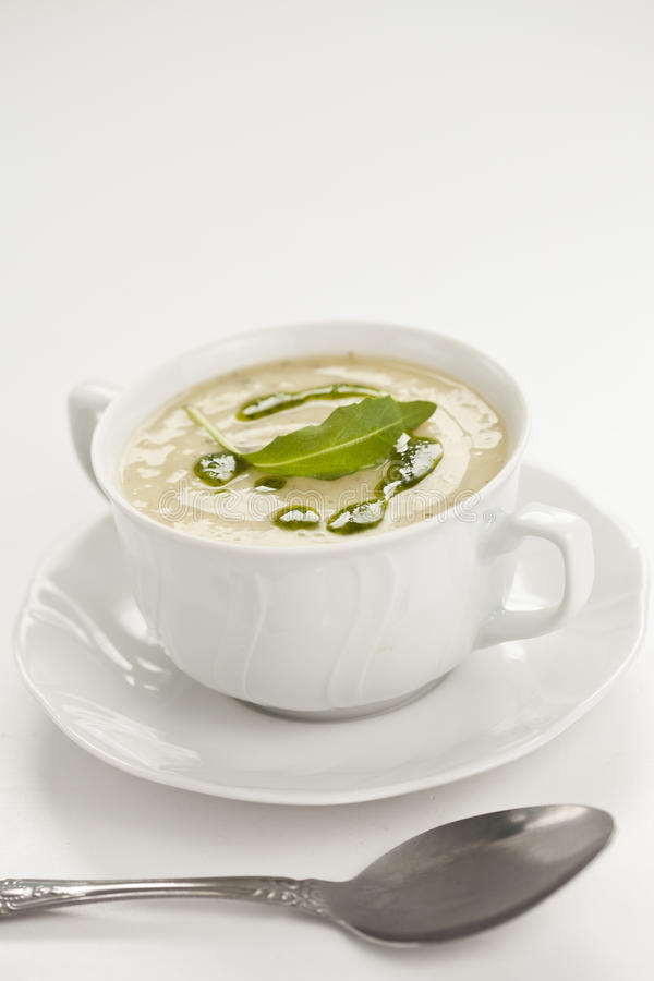 Leek soup. Tasty home made leek soup on white cup stock photography