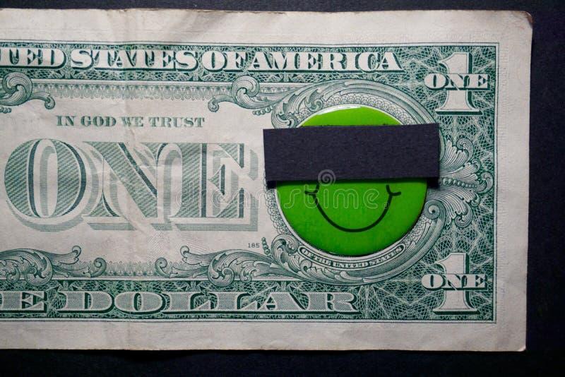 Leende en dollar royaltyfri fotografi