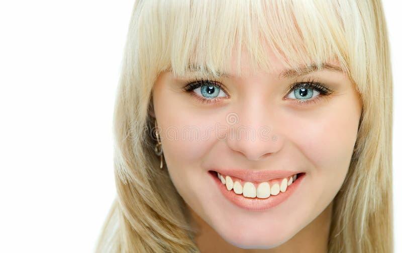 leende för blåa ögon arkivfoton