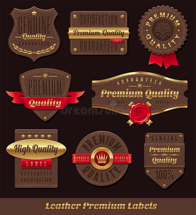 Leer & gouden premie en kwaliteitsetiketten royalty-vrije illustratie
