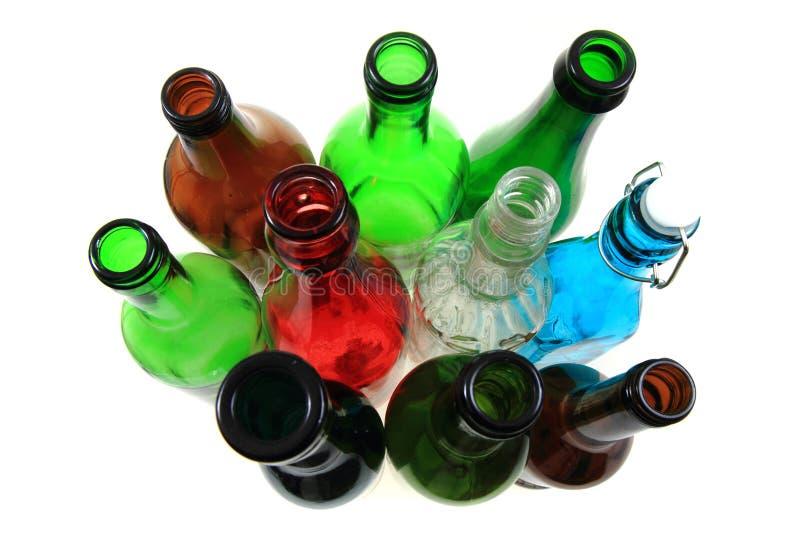 Leere Farbglasflaschen stockbilder