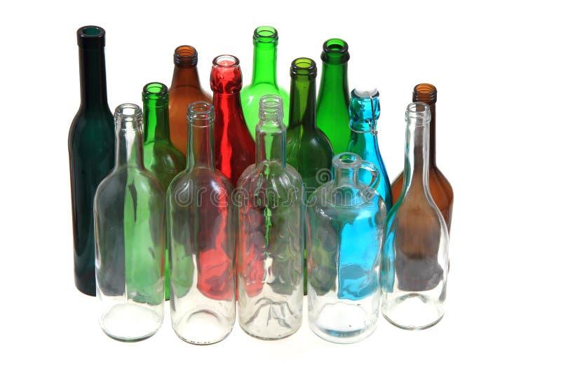 Leere Farbglasflaschen lizenzfreie stockfotos