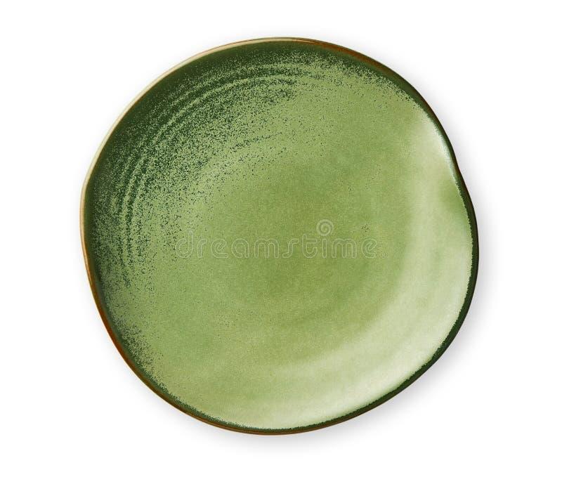 Leere grüne Platte mit gewelltem Rand, gekräuselte Platte im gewellten Profil, Ansicht von oben lokalisiert auf weißem Hintergrun stockbilder